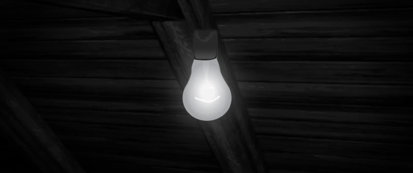 A light bulb in a sparse attic